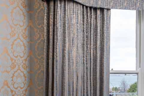 Beautiful wallpaper with bespoke pelmet and curtaining in the Dining Room