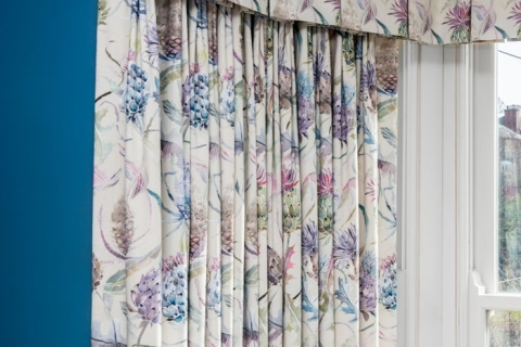 Beautifully made valance and curtaining in this bedroom