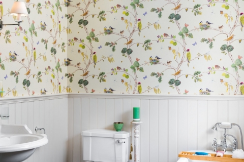 Beautiful wallpaper in bathroom.