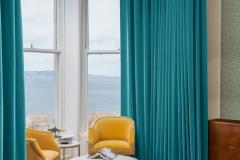 Bespoke pelmet and curtaining in fabulous teal velvet fabric