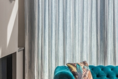 Contemporary voile curtains in the living area on wave heading.