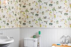 Beautiful wallpaper in bathroom.